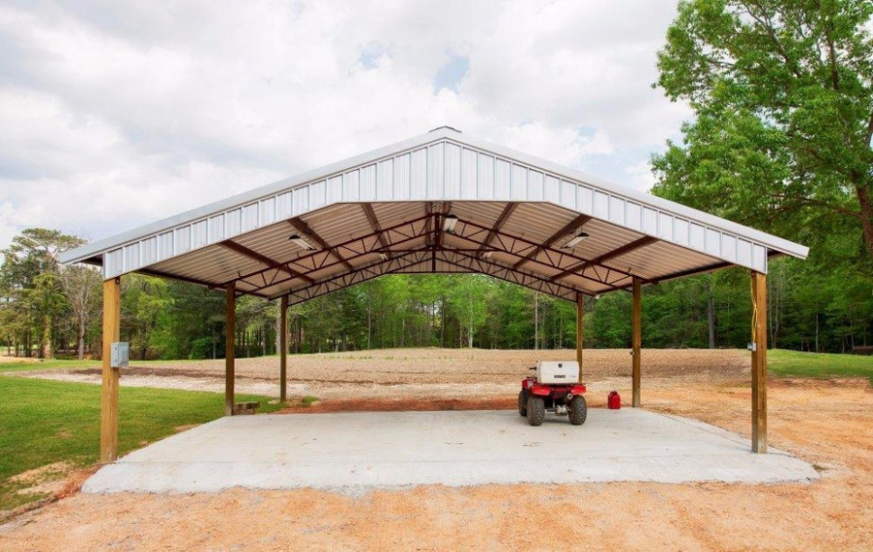 Open Shelter And Fully Enclosed Metal Pole Barns Smith Enclosed Carport Vs Pole Barn.jpg
