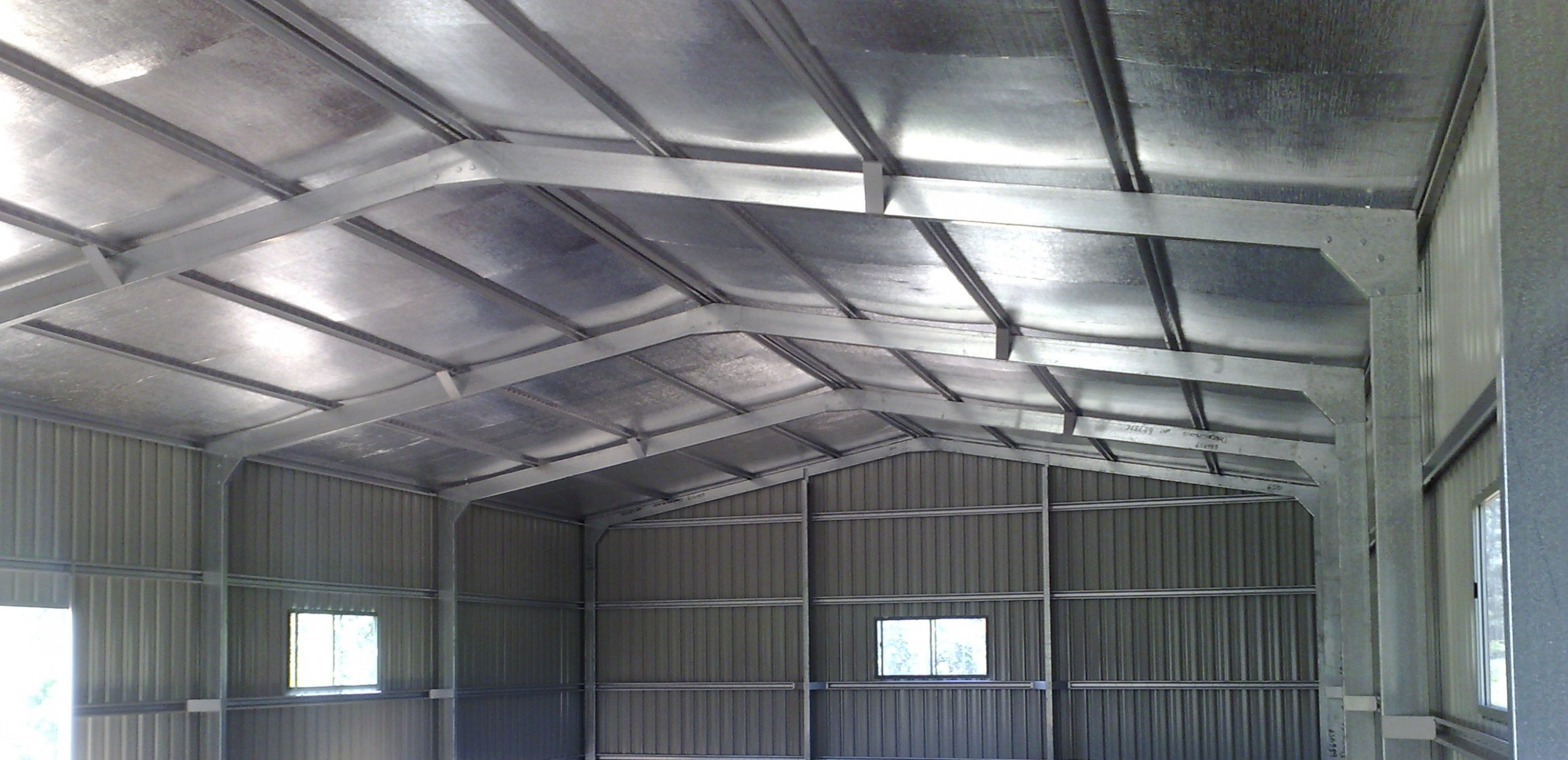 Insulating Your Shed Retrofitting Shed Insulation Steel Lining A Carport Roof.jpg