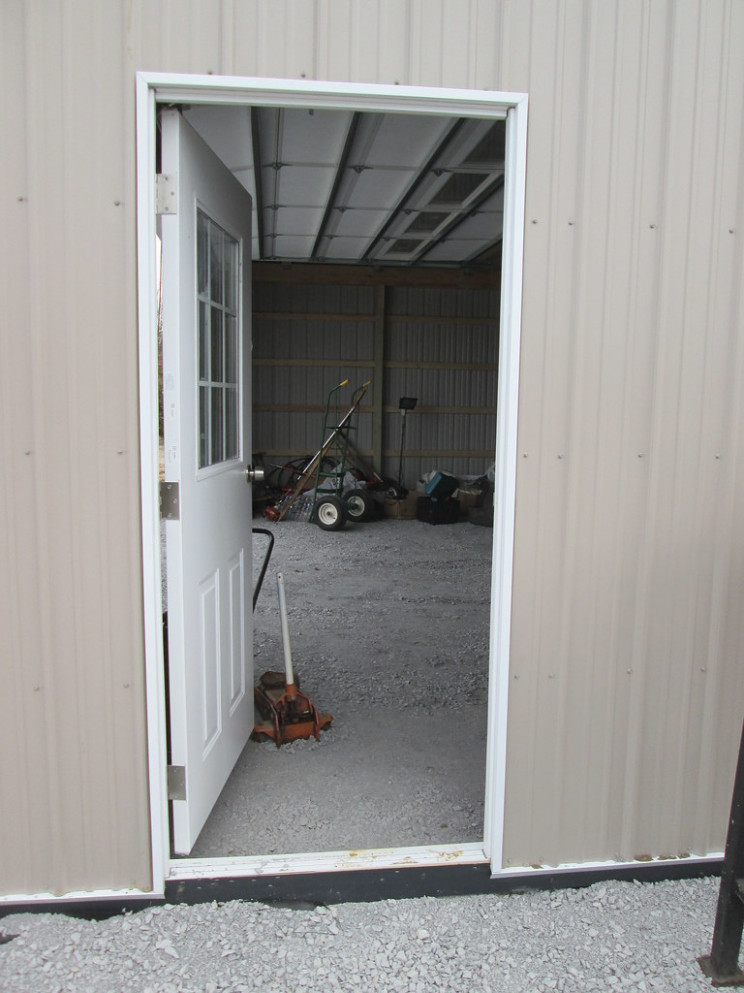 "30' W X 50' L X 10' 4"" H (ID# 429) Man Door Carports With Pitched Roofs"