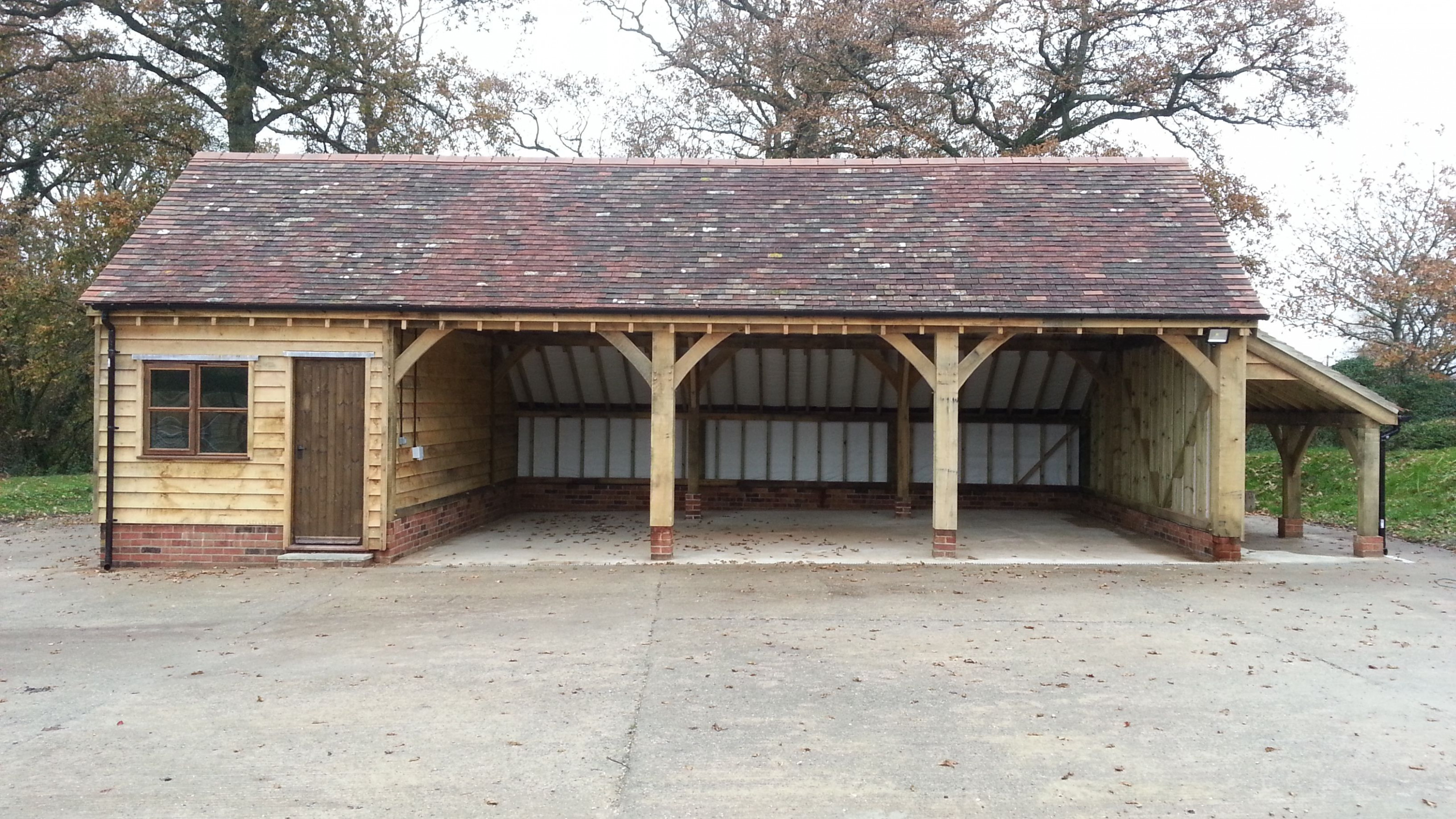 A Classic 4bay Garage With Workshop And Side Log Store ..