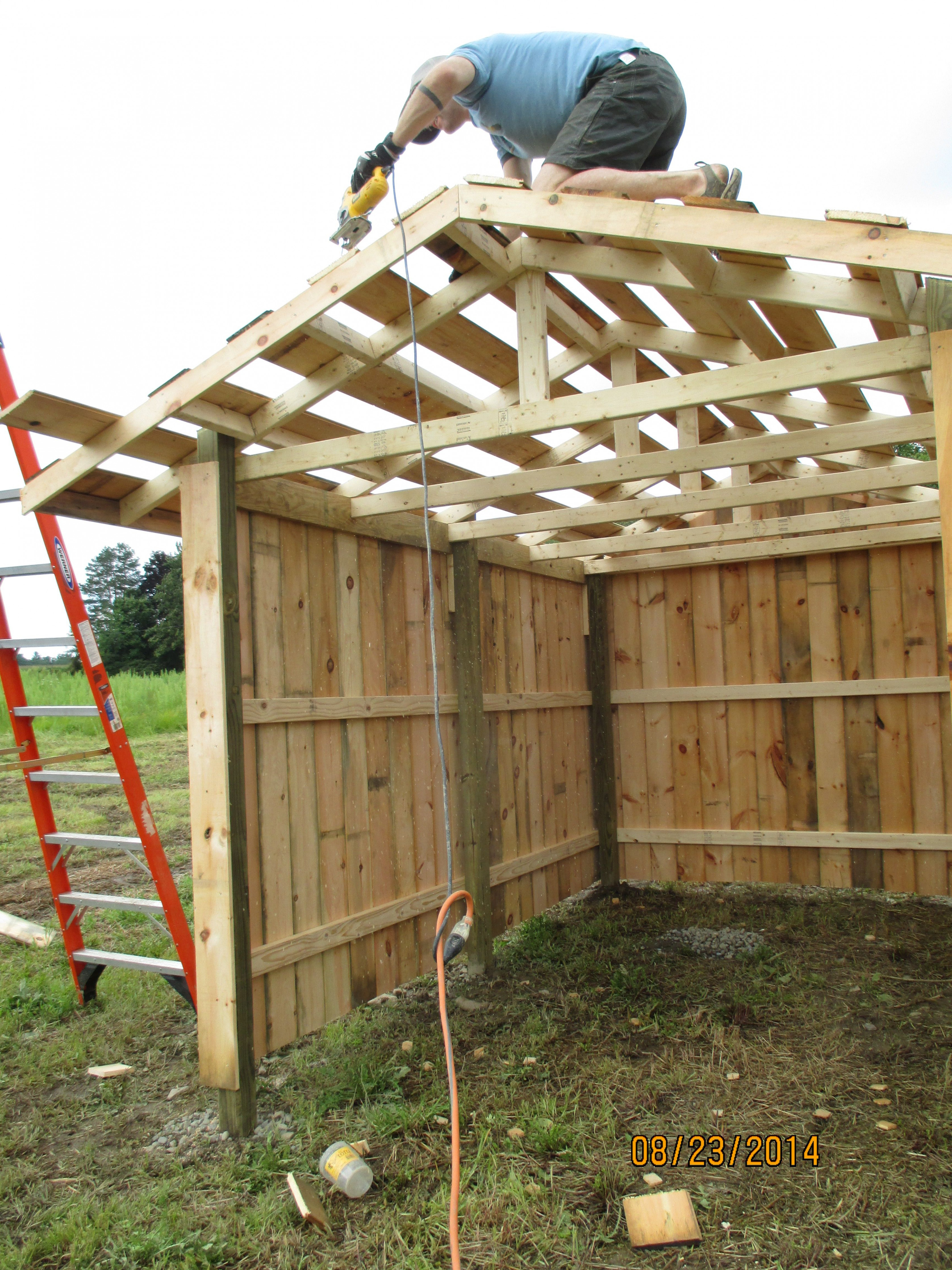 cleaning up the roof purlins on our small 9x9, three-sided ...