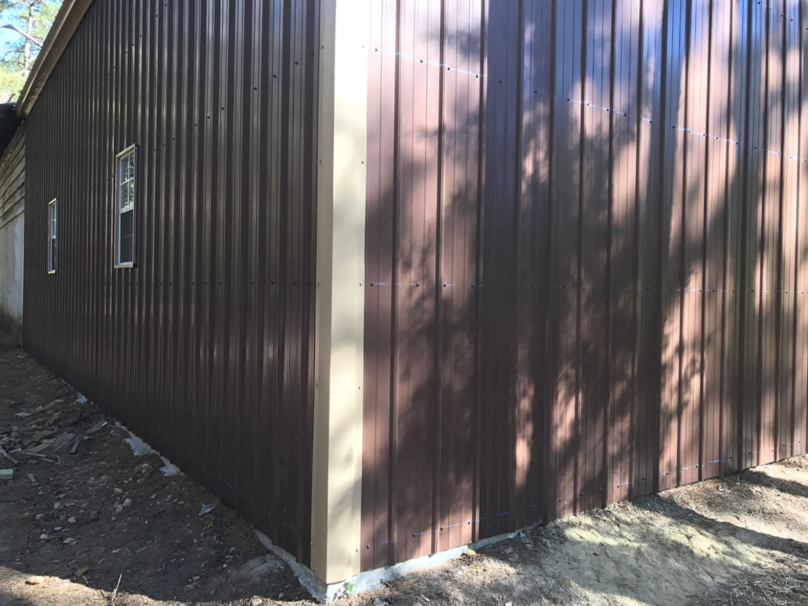 picture of a metal garage building with different steel trim ...