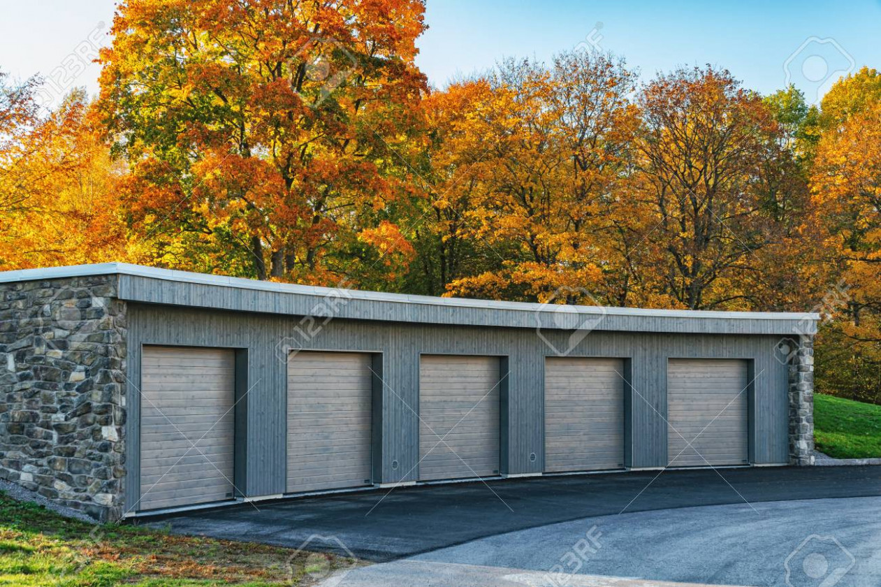 Set Of Carports Or Garages In A Row With Trees And Sky At The.