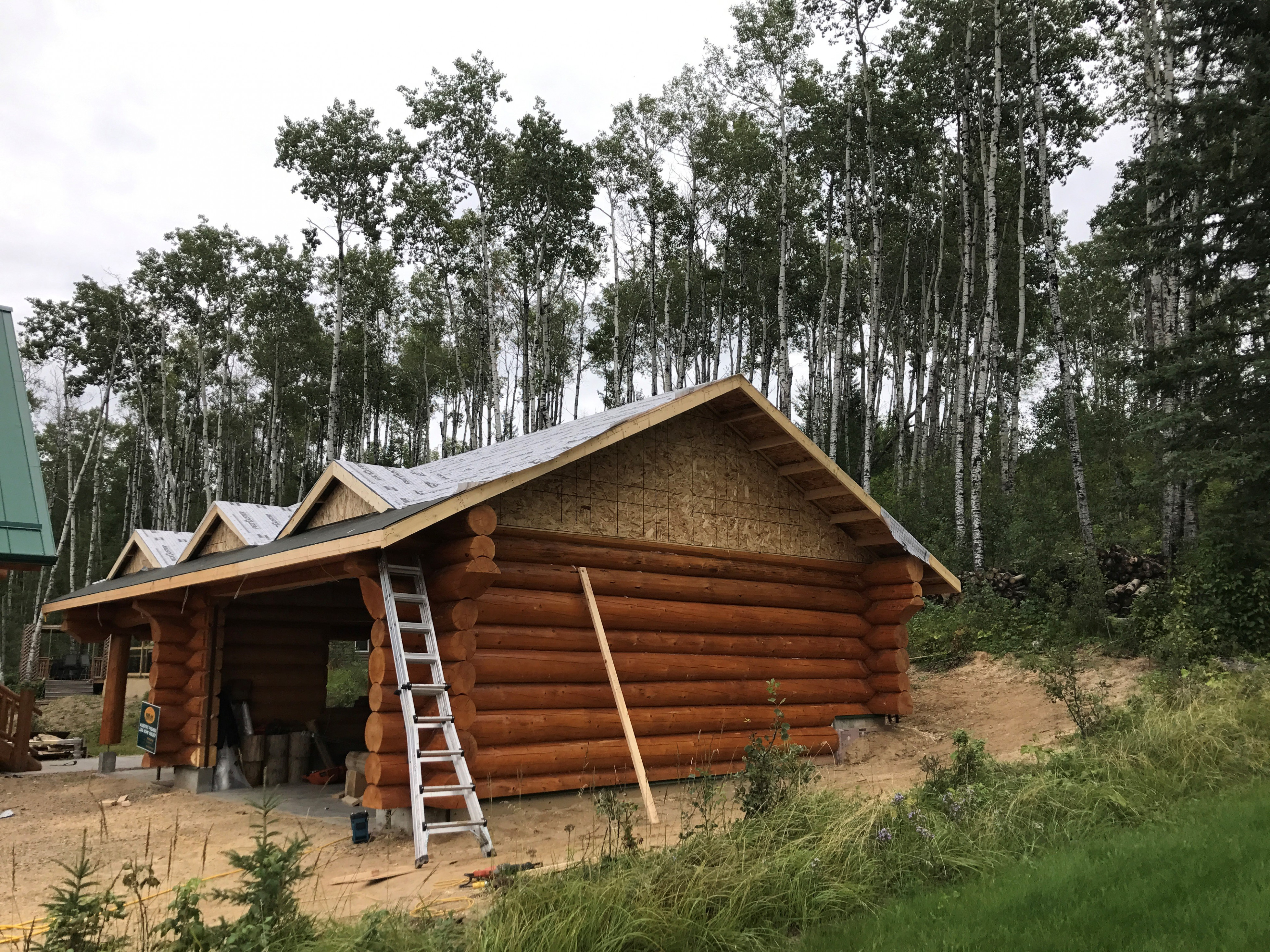This Log Garage And Carport Is An Addition To A Log Home ..