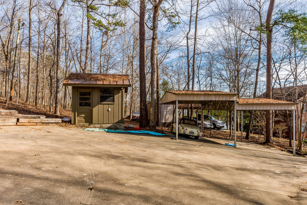 Two Carports, Storage Building And Lots Of Room For Parking! Parking Lot Carports