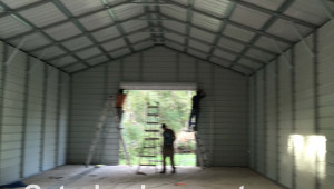 1517821373-gatorback-carports-look-inside-a-steel-garage-job-10-foot-tall-carport.jpg