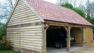 1517919737-oak-garages-fully-bespoke-oak-frame-timber-garages-oakley-framing-double-carports.jpg