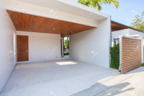 Interior And Exterior Design Of White Carport With Wooden Ceiling.